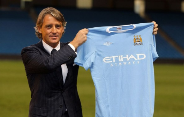 Man City could be 2012 Premier League title winners if Roberto Mancini releases the shackles