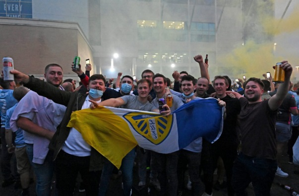 Leeds United fans celebrate being promoted to the Premier League